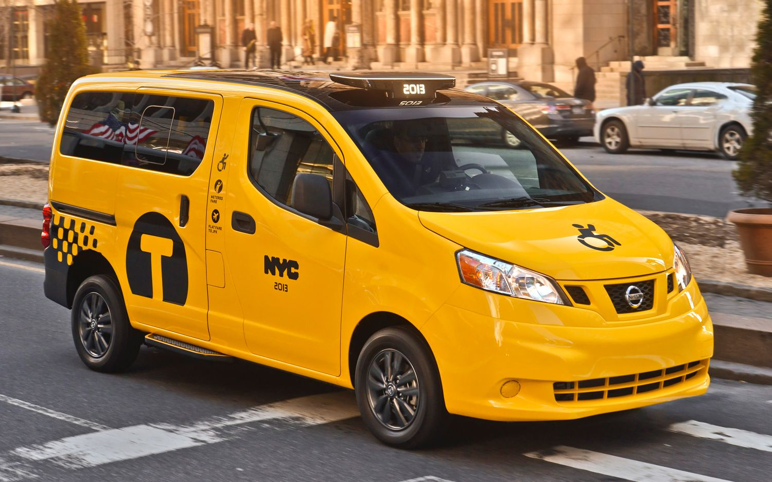 2014-nissan-nv200-mobility-ny-taxi-front-view-in-motion-02